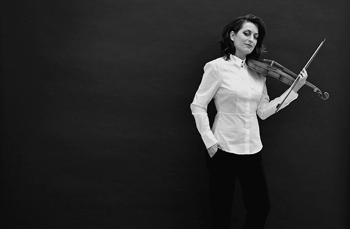 black and white photo of Elisa Citterio with violin