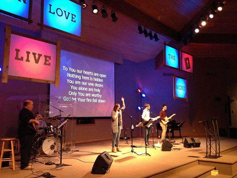 A contemporary worship team leads a congregation