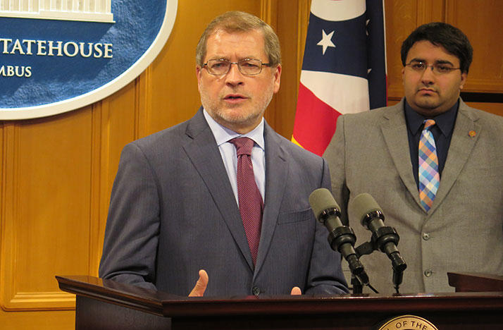 Grover Norquist of Americans for Tax Reform speaks at the Ohio Statehouse with Republican State Rep Niraj Antani in background.