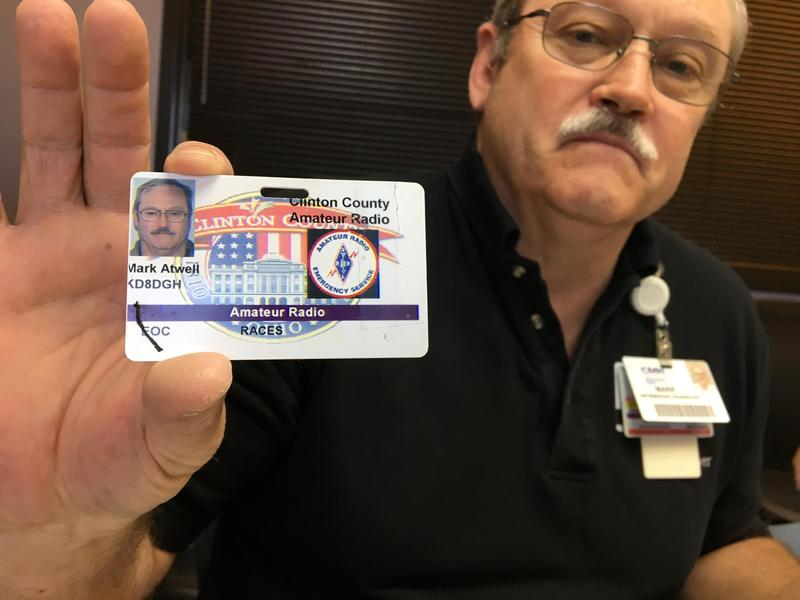 Mark Atwell, a ham radio operator, shows off his amateur radio license.