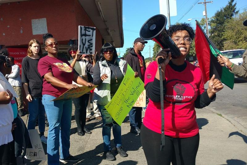 Hana X Abdur Rahim, a leader of the People's Justice Project, protests at a rally for Timothy Davis.