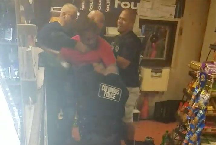 Columbus police officer struggle to subdue Timothy Davis during a September 1 arrest.