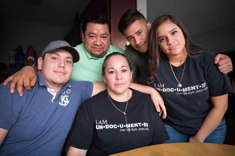 Edith Espinal, center, surrounded by her family members.