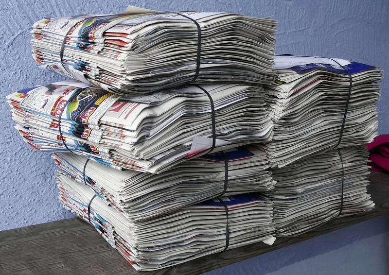 Stacks of newspapers waiting for delivery
