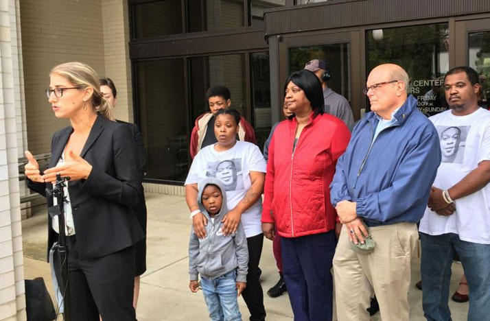 Plaintiffs' Sarah Gelsomino and members of the Stewart family outside Euclid City Hall Monday.
