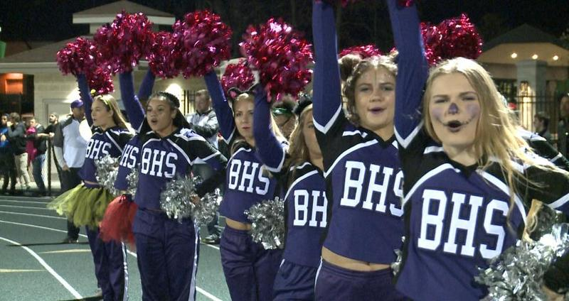 Barberton High School's cheerleaders cheer on their undefeated football team at a game at Highland High School.