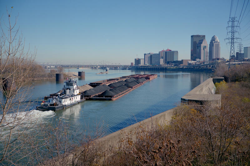A towboat with coal goes up the Ohio River near Louisville, Ky.