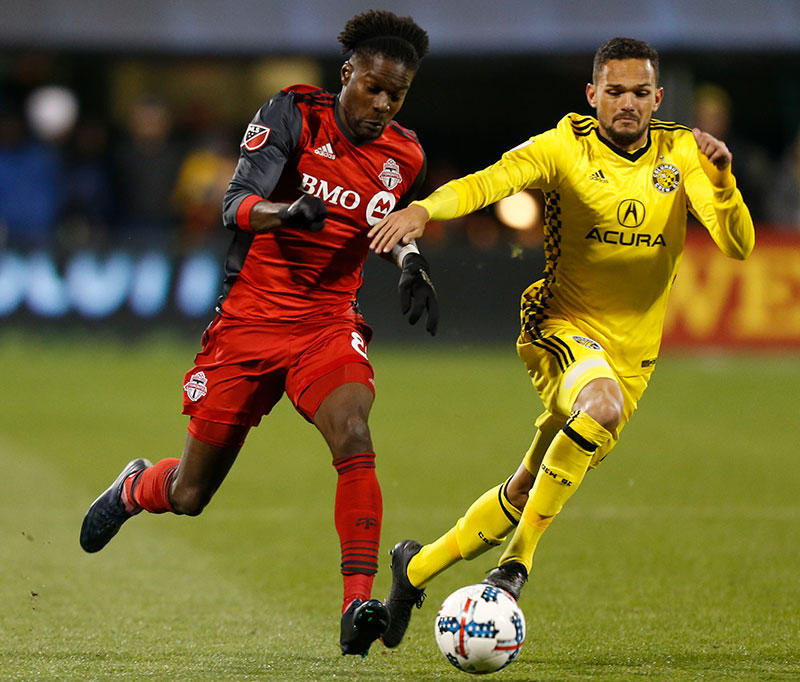 Columbus Crew's Artur (right) and Toronto FC's Tosaint Ricketts chase a loose ball during the an MLS Eastern Conference championship soccer match Tuesday, Nov. 21, 2017, in Columbus, Ohio.