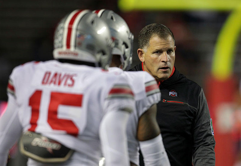 Ohio State associate head coach/ defensive coordinator Greg Schiano talks to his players during an NCAA college football game against Rutgers Saturday, Sept. 30, 2017, in Piscataway, N.J.