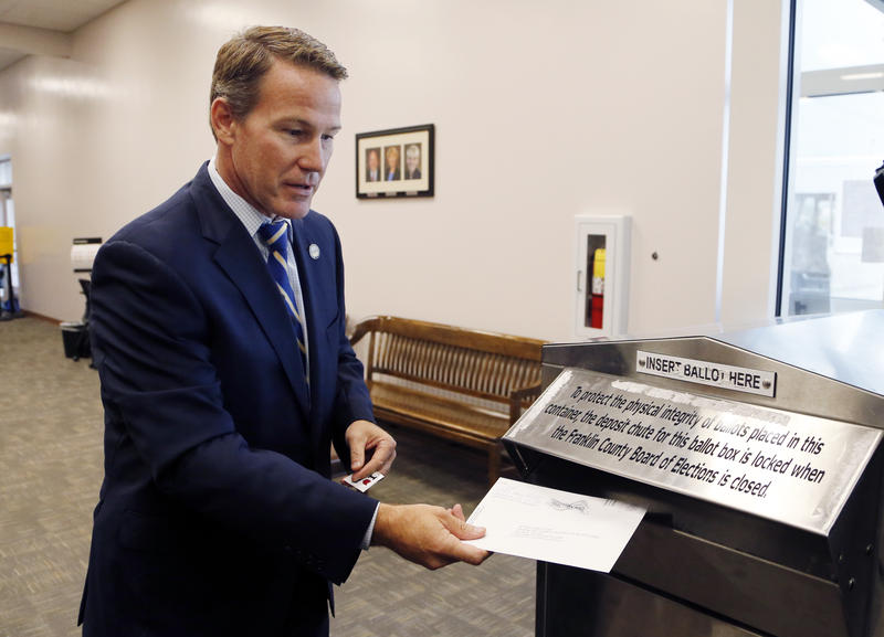 Ohio Secretary of State Jon Husted voting in the 2016 election. Husted's office has purged thousands of voters for being inactive.