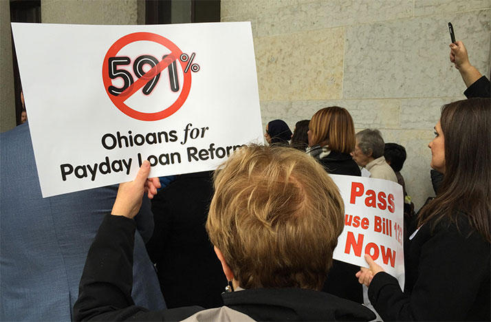 Supporters of a bill that reform payday lending gather at the Ohio Statehouse.