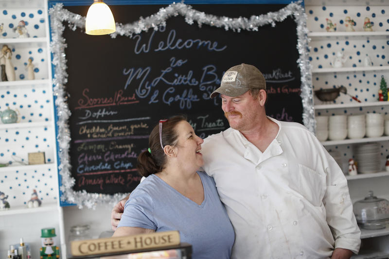 Sacramento natives Larry Monson, right, and his wife Malana embrace in their My Little Bakery & Coffee Shop, opened less than two weeks earlier in Corning, Ohio.