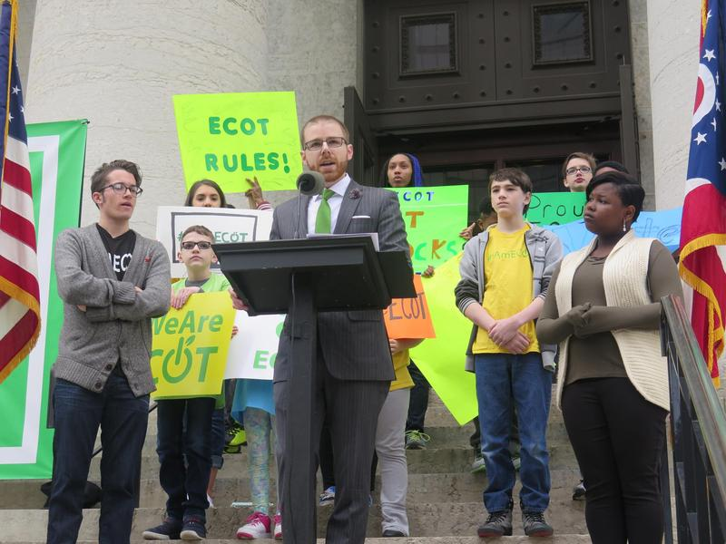 ECOT Board President Andrew Brush addressed a crowd in front of the Statehouse in May.