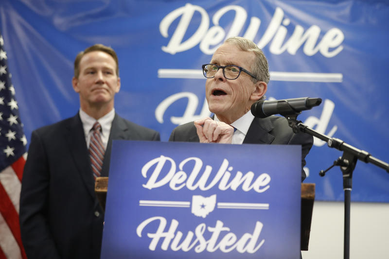 Ohio Republican Governor candidate Mike DeWine speaks while running mate Jon Husted looks on.