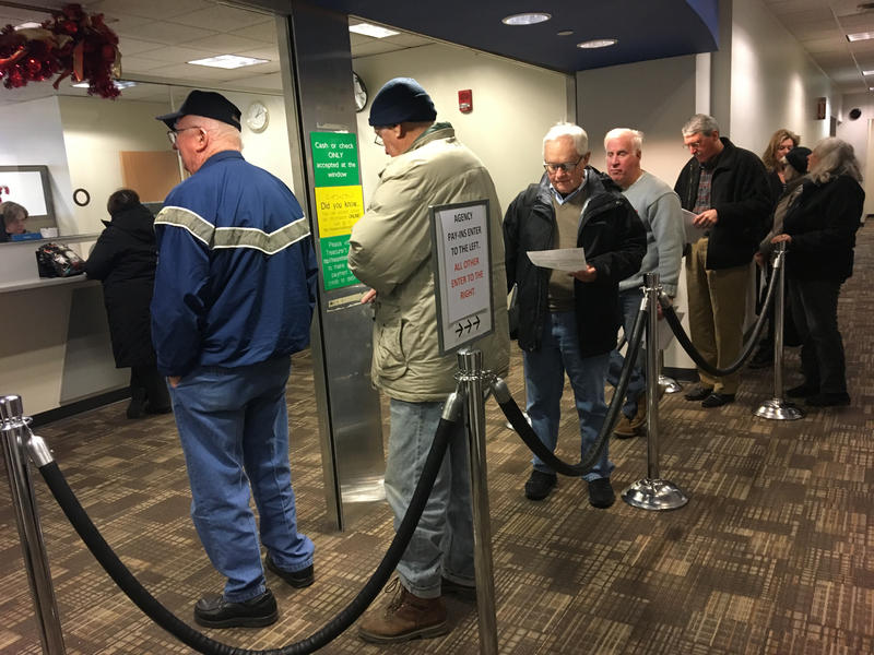 Homeowners line up at the Franklin County Treasurer's Office. Many are hoping to pre-pay their 2018 property tax before the end of 2017.
