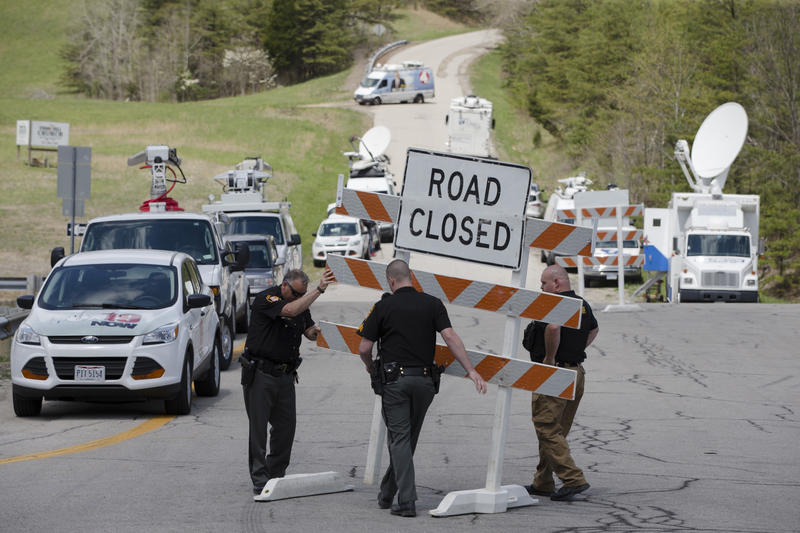 Authorities set up roadblocks at the perimeter of one of four properties near Piketon, Ohio following the murders of the Rhoden family on June 21, 2016.