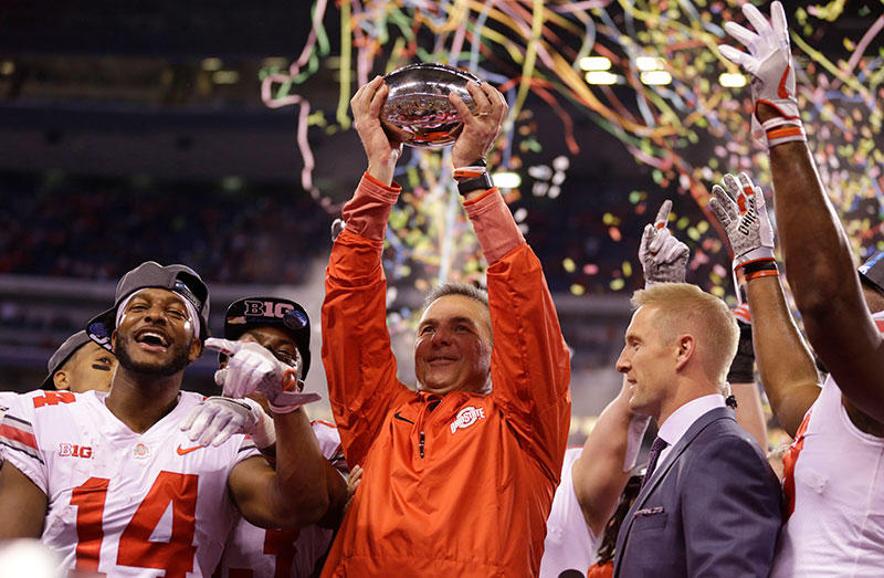 Ohio State head coach Urban Meyer holds the championship trophy following the Big Ten championship NCAA college football game against Wisconsin, Sunday, Dec. 3, 2017, in Indianapolis. Ohio State won 27-21.