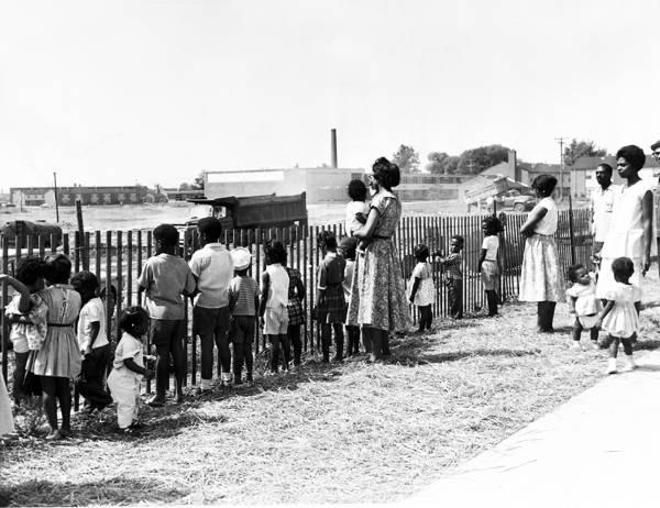 Garden Valley residents look at the landfill, 1961. Waste dumps tend to be concentrated in areas where minorities live.