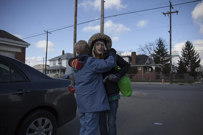 Sister Nadine of the Sisters devotion embraces one of the many women she helps in the Hilltop area of Columbus.