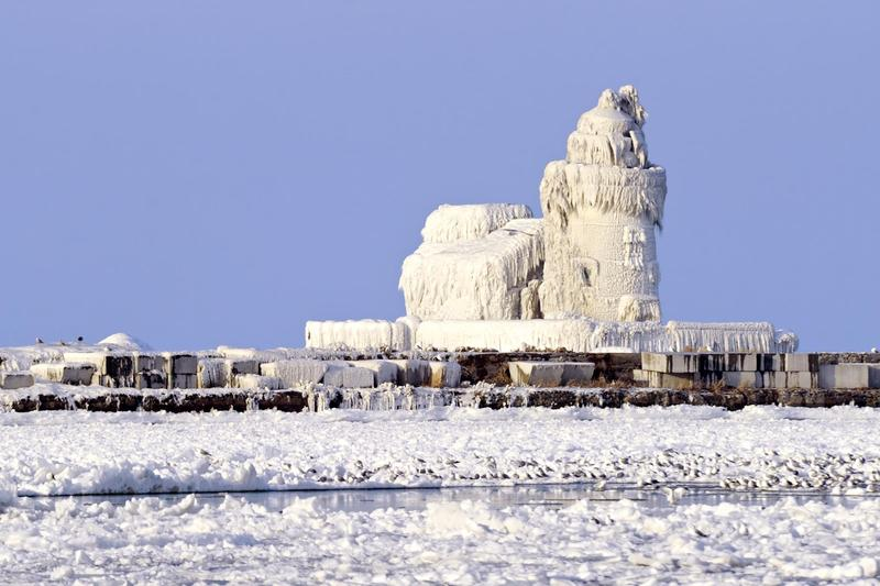 The Cleveland Harbor West Pierhead Lighthouse covered in ice.