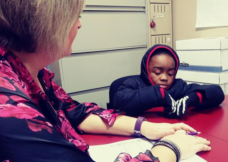 Victor Small, 7, talks with registered nurse Julie Cicero abut his asthma.