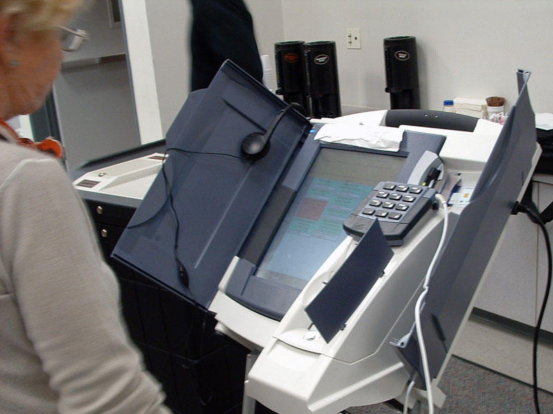 A woman votes using a Diebold Elections System AccuVote-TSx DRE voting machine used in 41 counties in Ohio.