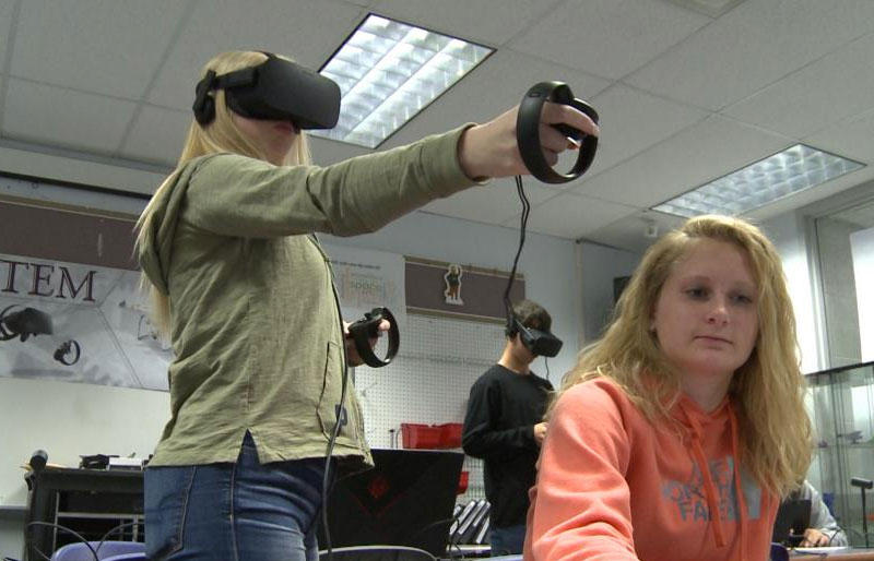 A pair of Barberton High School students test their virtual reality technology.