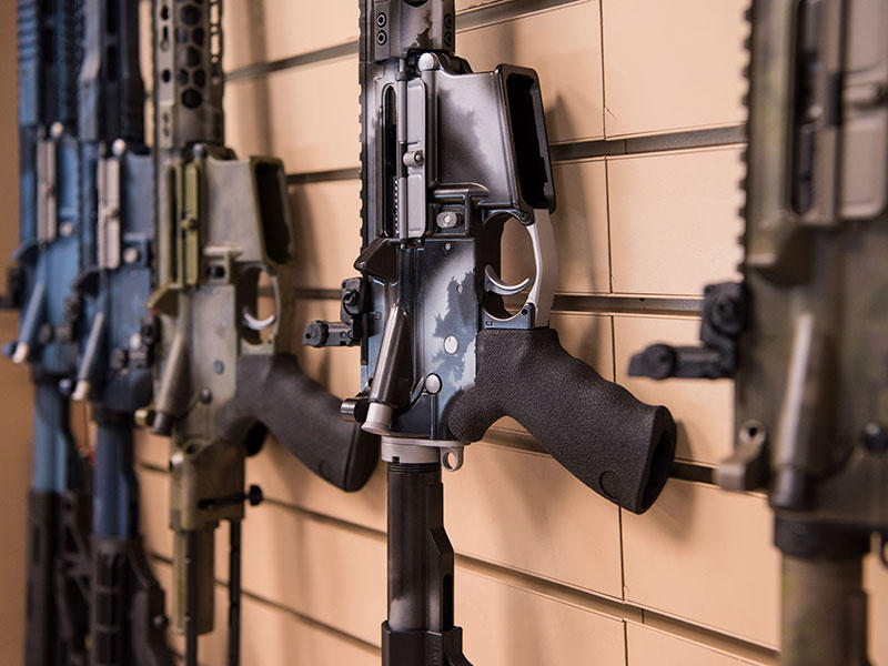 AR-15 style rifles made by Battle Rifle Co., a gunmaker in Webster, Texas, are on display in its retail shop.