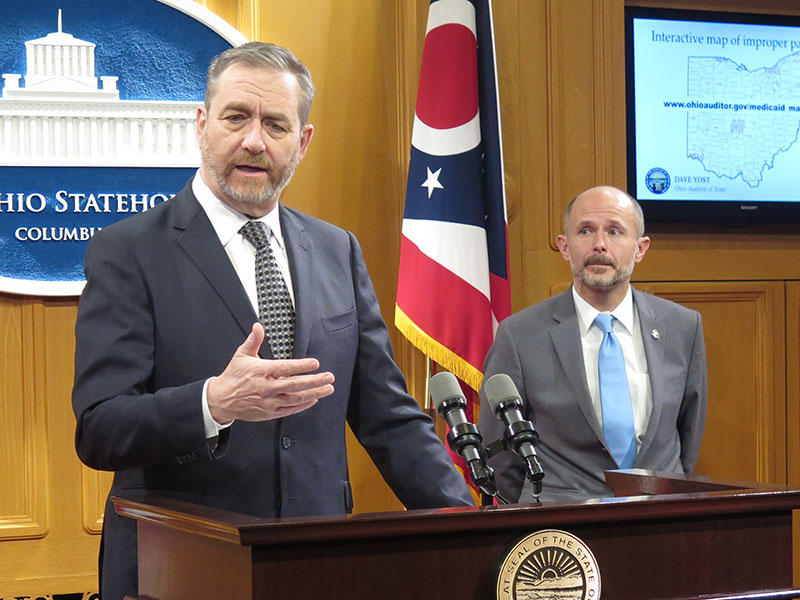 Auditor Dave Yost (left) discusses the bill alongside Sen. Dave Burke (R-Marysville), the chair of the Health, Human Services and Medicaid committee.