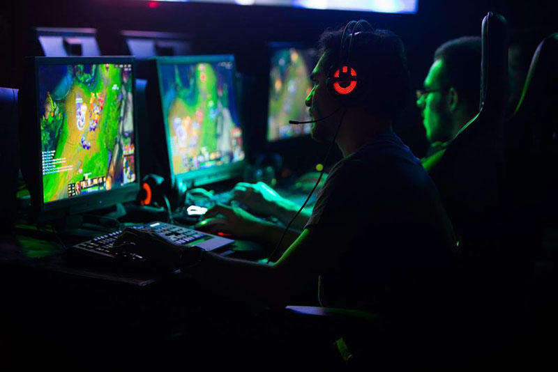 eSport gamers play League of Legends during a competion.