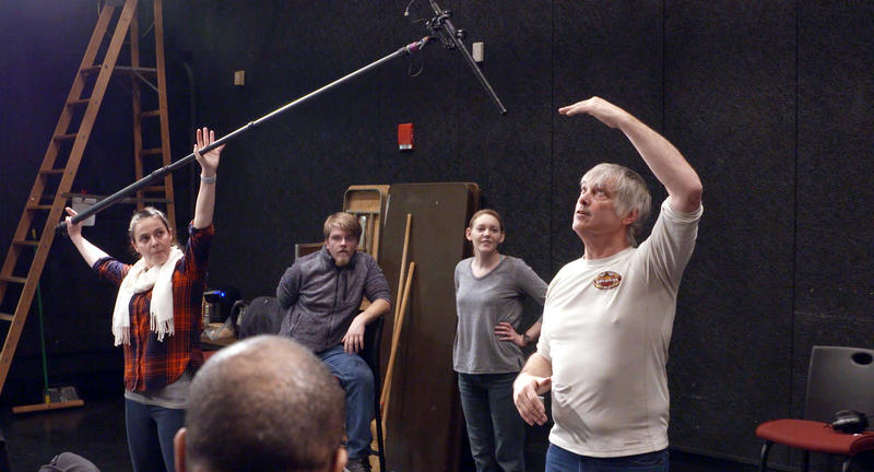 As part of a five-week crash course in film production, sound recordist Jonathan Andrews shows students at Cuyahoga Community College how to hold a mic boom.