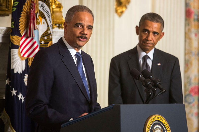 Attorney General Eric H. Holder Jr., delivers remarks following President Barack Obama's statement announcing Holder's departure, in the State Dining Room of the White House, Sept. 25, 2014.