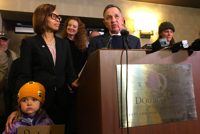 Dennis Kucinich along with running mate Tara Samples call for Ohio cities to lobby for assult weapon bans in Cleveland on Monday.