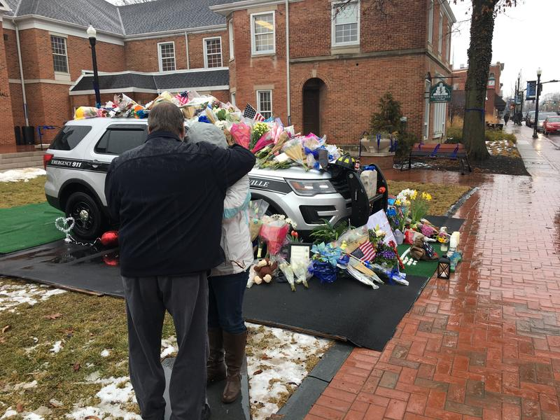 Two people embrace at a memorial for two Westerville officers killed on Saturday.