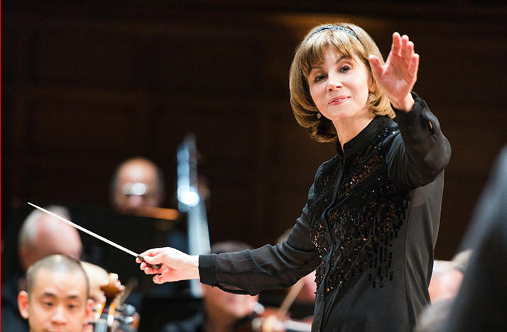 color photo of conductor JoAnn Falletta conducting
