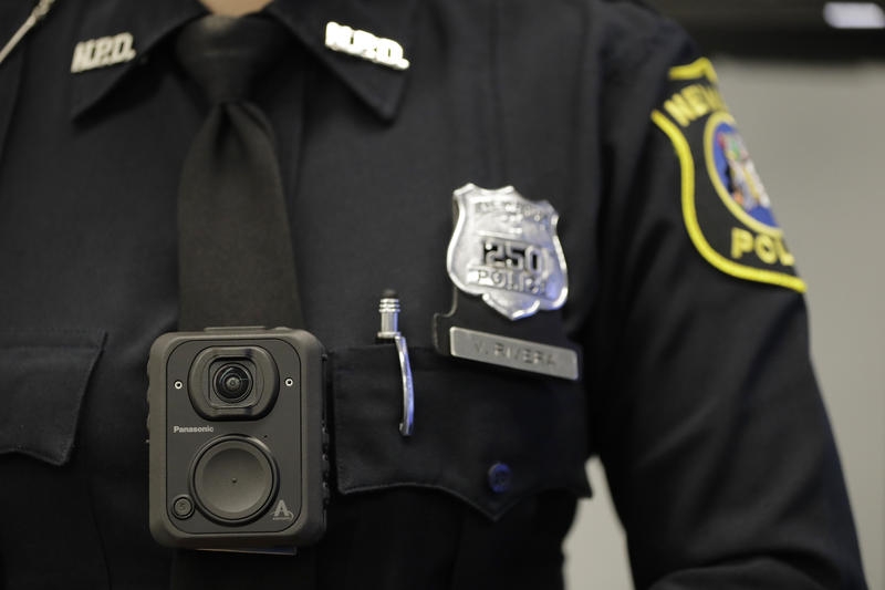 Newark Police officer Veronica Rivera wears a body camera during a news conference at the Panasonic headquarters unveiling body cameras for officers, Wednesday, April 26, 2017, in Newark, New Jersey.