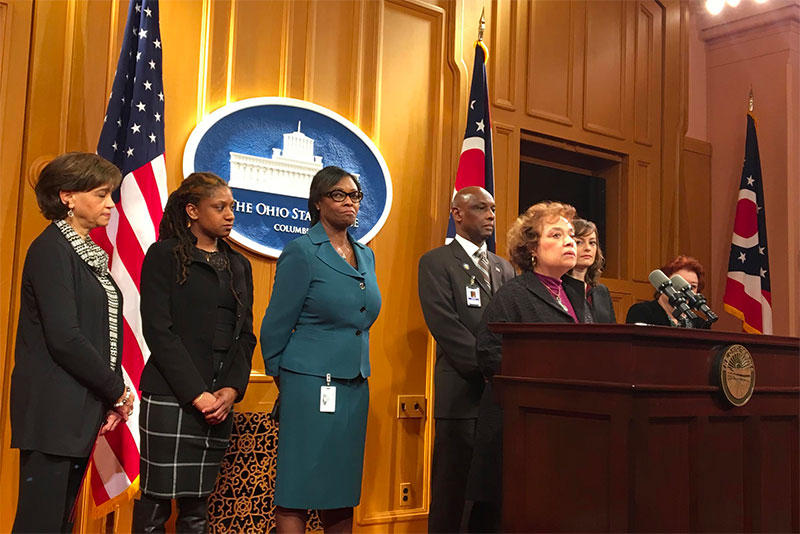 Senator Charleta Tavares and backers of her sexual harassment bill at the Ohio Statehouse.