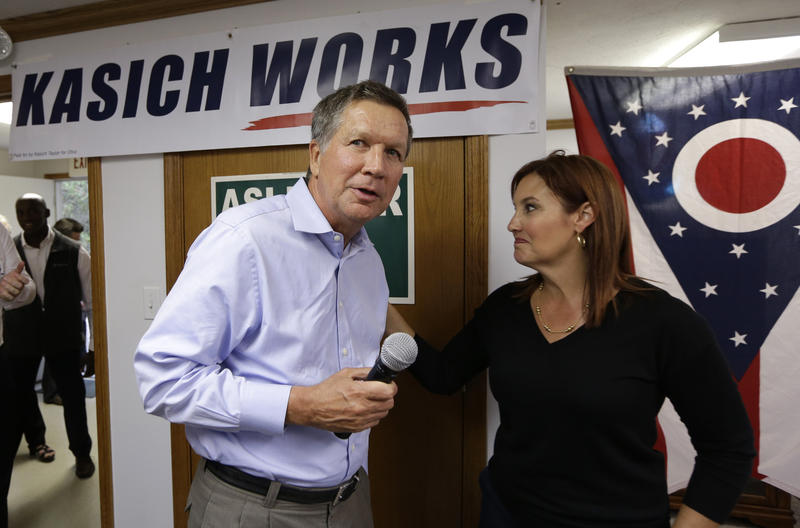 Ohio Gov. John Kasich is introduced by Lt. Gov. Mary Taylor during a rally at Darke County GOP headquarters, Monday, Oct. 13, 2014, in Greenville, Ohio.