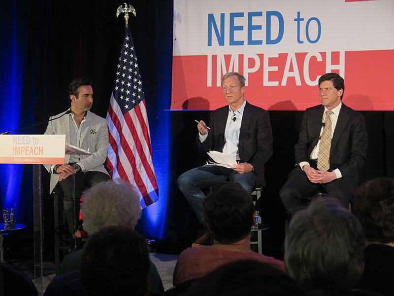 "Tom Steyer, center, talks to attendees at his ""Need to Impeach"" town hall in Columbus."