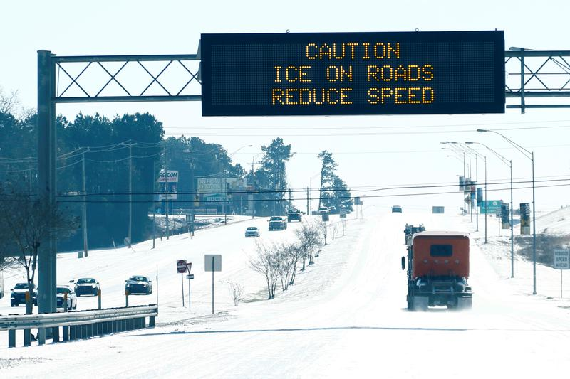 Motorists along Interstate 49 deal with icy roads in Hattiesburg, Missouri.