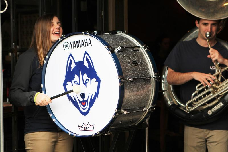 A member of the UConn pep band plays in downtown Columbus on Thursday.
