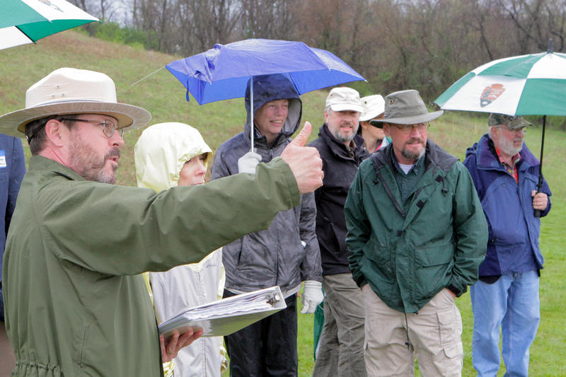 From a rise next to the Hopeton Earthworks, archaeologist Bret Ruby points to the few remaining features that formed the boundaries of the structure.