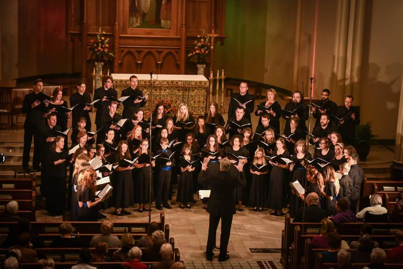 color photo of LancasterChorale singing in a concert in a church