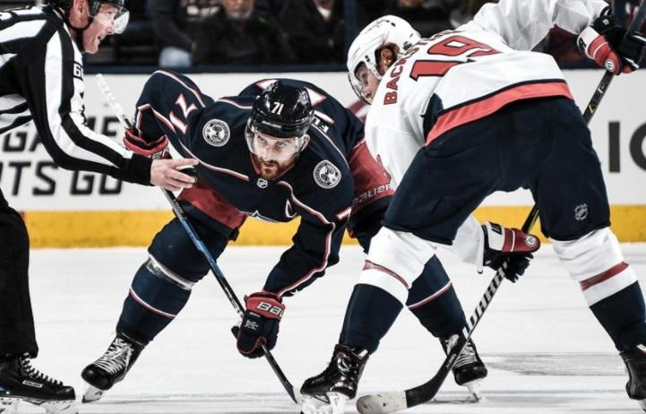 Columbus' Nick Foligno (left) and Washington's Nicklas Backstrom face off during Tuesday's Game 3 inside Nationwide Arena.