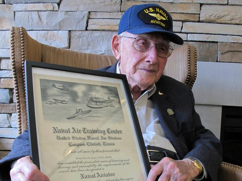 n this Wednesday, April 25, 2018 photo, World War II veteran Bob Barger poses with his Naval flight school certificate in Toledo, Ohio.