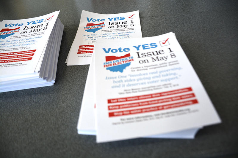 A stack of pro-Issue 1 pamphlets sit on a table at the Democratic gubernatorial debate in Cleveland Heights over the weekend.