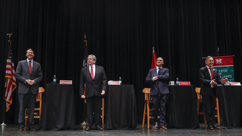 From left, Richard Cordray, former federal consumer protection chief; William O'Neill, former Ohio Supreme Court Justice; Ohio state Sen. Joe Schiavoni; and former U.S. Rep. Dennis Kucinich of Ohio stand at the start of the fifth debate.