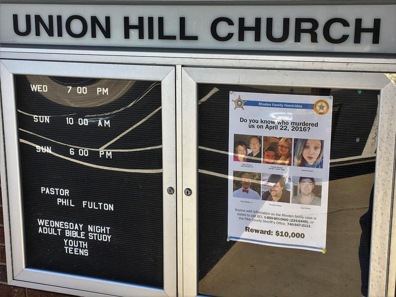 A flier hangs in a church sign about one year after eight members of the Rhoden family were found murdered inside several Pike County homes.