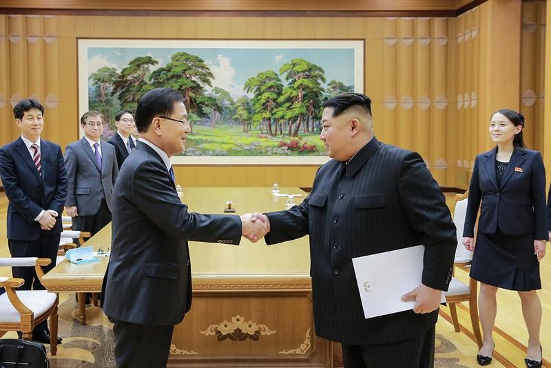 North Korean President Kim Jong-Un shakes South Korea president Moon Jae-in's hand.