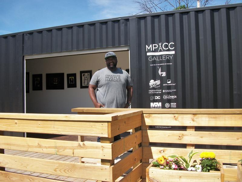 Marshall Shorts stands outside the art gallery shipping container.